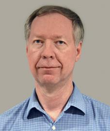 Dennis E. Petett